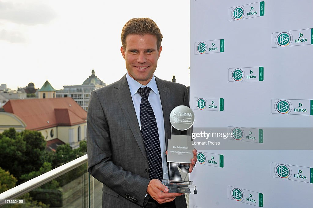 Referee <a gi-track='captionPersonalityLinkClicked' href=/galleries/search?phrase=Felix+Brych&family=editorial&specificpeople=707645 ng-click='$event.stopPropagation()'>Felix Brych</a> poses with his trophy during the Referee Of The Year 2013 awarding ceremony at Hotel Bayerischer Hof on August 29, 2013 in Munich, Germany.
