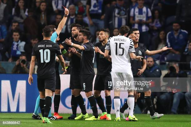 Referee Felix Brych shows a red card to Alex Telles of FC Porto during the UEFA Champions League Round of 16 first leg match between FC Porto and...