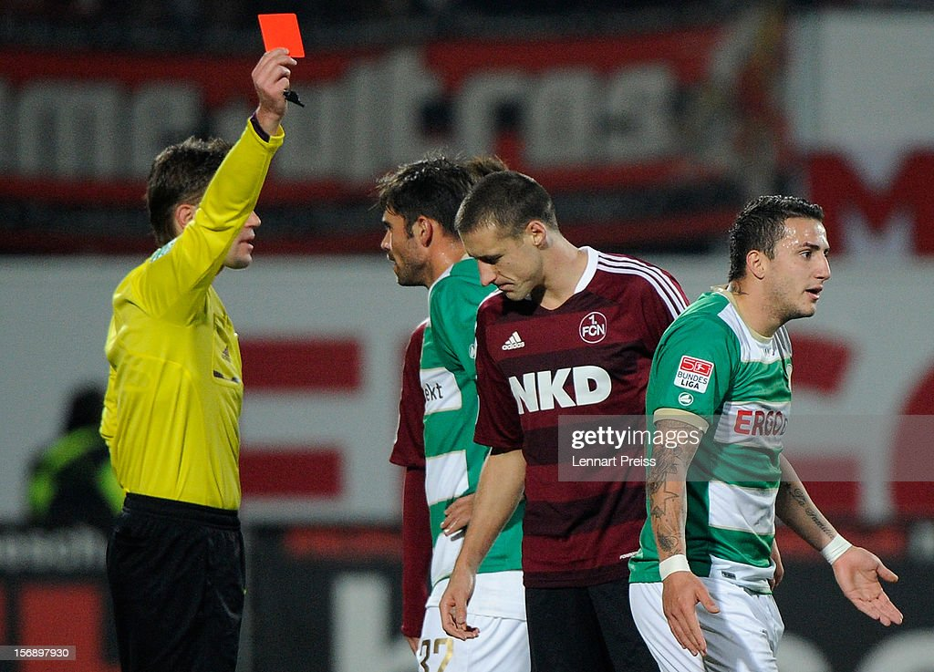 Referee <a gi-track='captionPersonalityLinkClicked' href=/galleries/search?phrase=Felix+Brych&family=editorial&specificpeople=707645 ng-click='$event.stopPropagation()'>Felix Brych</a> (L) shows Sercan Sararer (R) of Fuerth the red card during the Bundesliga match between SpVgg Greuther Fuerth and 1. FC Nuernberg at Trolli-Arena on November 24, 2012 in Fuerth, Germany.