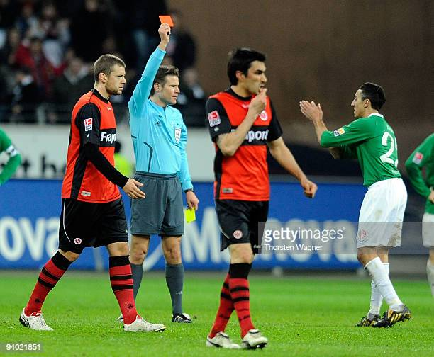 Referee Felix Brych shows the red card to Chadli Amri of Mainz during the Bundesliga match between Eintracht Frankfurt and FSV Mainz 05 at...