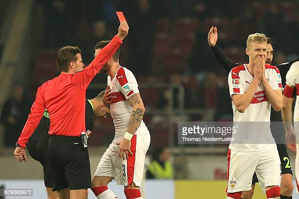 Referee Felix Brych showsa the red card to Timo Baumgartl of Stuttgart during the Second Bundesliga match between VfB Stuttgart and Hannover 96 at...