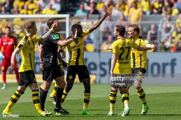 Referee Felix Brych speak with Ousmane Dembele of Dortmund Gonzalo Castro of Dortmund and Marcel Schmelzer of Dortmund during the Bundesliga match...