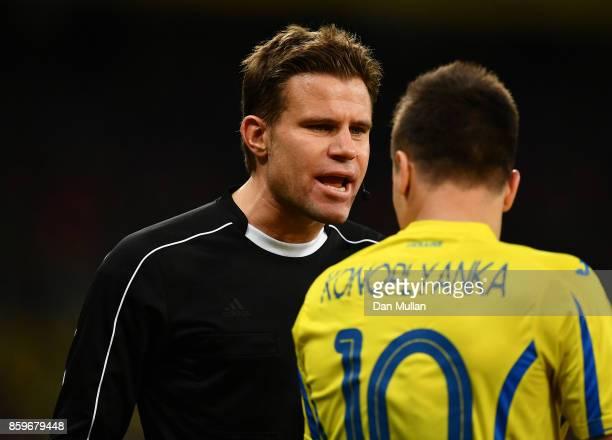Referee Felix Brych talks to Yevhen Konoplyanka of Ukraine during the FIFA 2018 World Cup Qualifier Group I match between Ukraine and Croatia at Kiev...