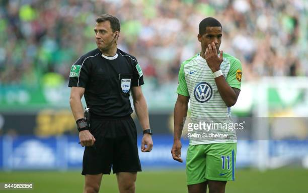 Referee Felix Zwayer and Daniel Didavi look on during the Bundesliga match between VfL Wolfsburg and Hannover 96 at Volkswagen Arena on September 9...