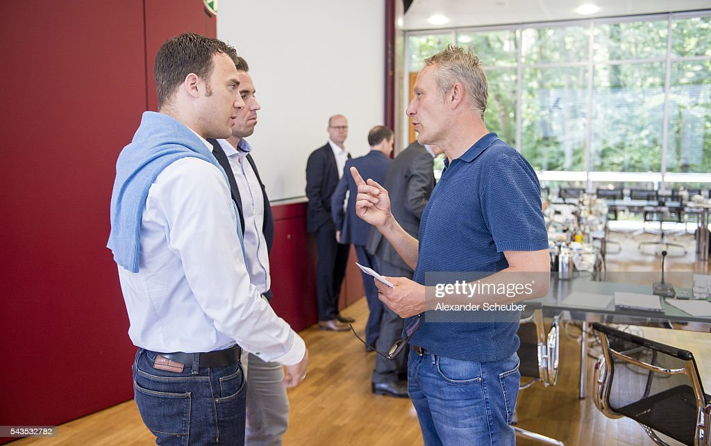 Referee Felix Zwayer and head coach <a gi-track='captionPersonalityLinkClicked' href=/galleries/search?phrase=Christian+Streich&family=editorial&specificpeople=4411796 ng-click='$event.stopPropagation()'>Christian Streich</a> of SC Freiburg discuss prior the DFB referee's - round table at DFB Headquarter on June 29, 2016 in Frankfurt am Main, Germany.