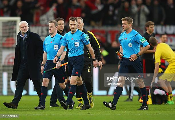 Referee Felix Zwayer and officials walk off the pitch after the Bundesliga match between Bayer Leverkusen and Borussia Dortmund at BayArena on...