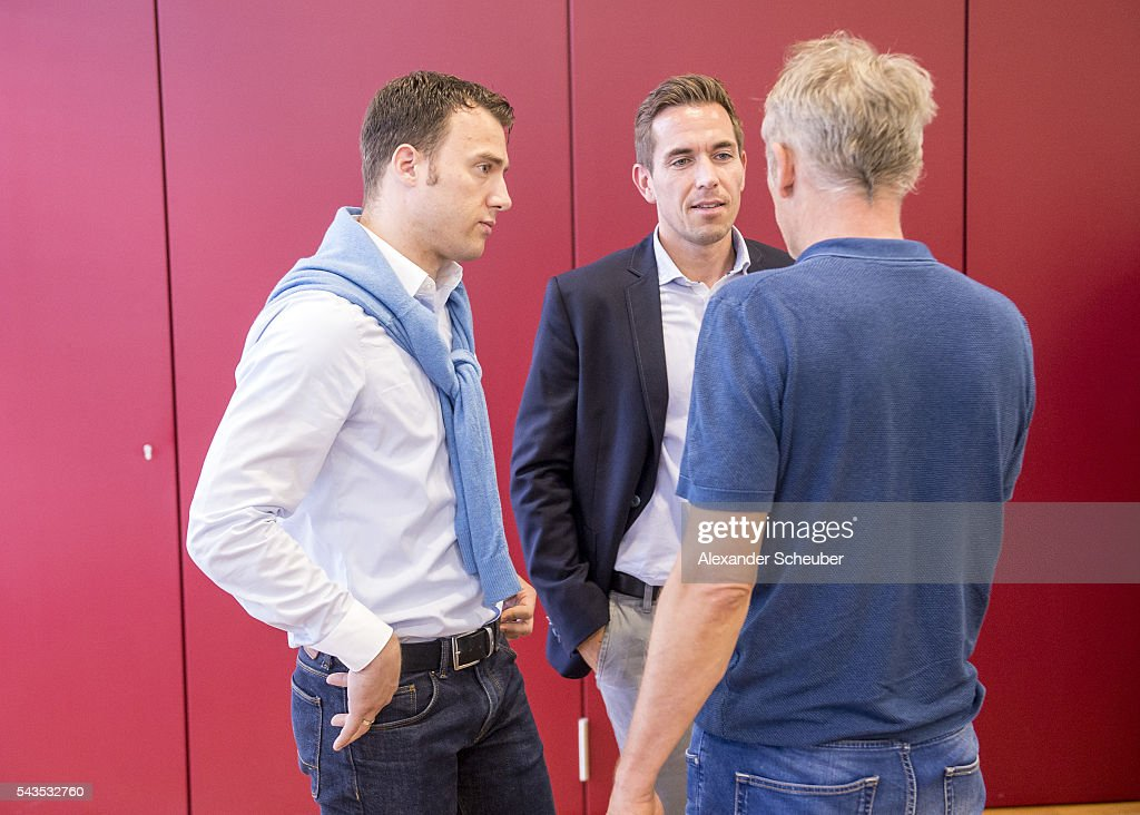 Referee Felix Zwayer and referee Tobias Stieler discuss with head coach <a gi-track='captionPersonalityLinkClicked' href=/galleries/search?phrase=Christian+Streich&family=editorial&specificpeople=4411796 ng-click='$event.stopPropagation()'>Christian Streich</a> of SC Freiburg prior the DFB referee's - round table at DFB Headquarter on June 29, 2016 in Frankfurt am Main, Germany.