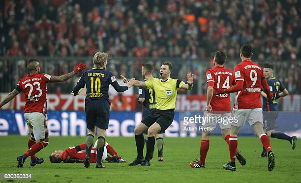 Referee Felix Zwayer calls for a foul as Emil Forsberg of RB Leipzig fouls Philipp Lahm of Bayern Muenchen during the Bundesliga match between Bayern...