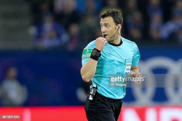 Referee Felix Zwayer controls the ball during the Bundesliga match between Hamburger SV and Borussia Dortmund at Volksparkstadion on September 20...