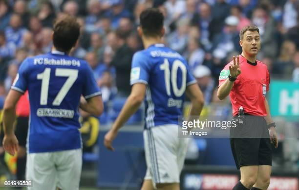 Referee Felix Zwayer gestures during the Bundesliga match between FC Schalke 04 and Borussia Dortmund at VeltinsArena on April 1 2017 in...