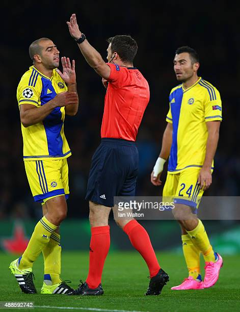 Referee Felix Zwayer has words with Tal Ben Haim I of Maccabi Tel Aviv during the UEFA Chanmpions League group G match between Chelsea and Maccabi...