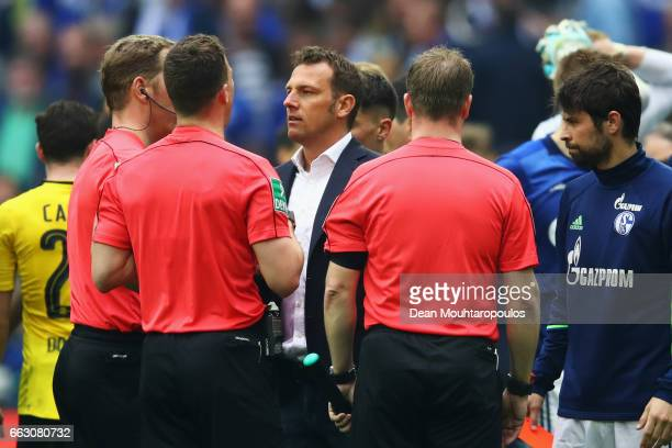 Referee Felix Zwayer is confronted by Schalke Manager / Head Coach Markus Weinzierl after the Bundesliga match between FC Schalke 04 and Borussia...