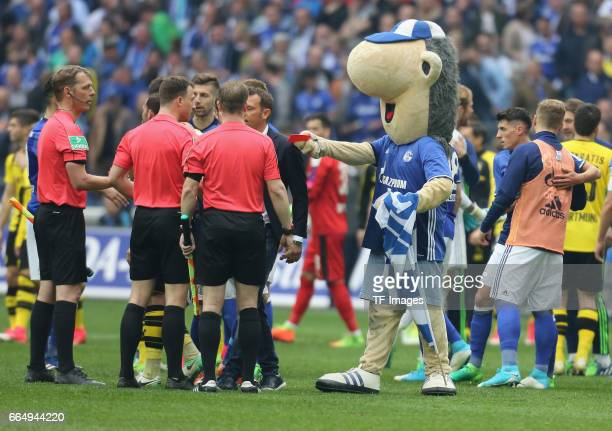 Referee Felix Zwayer is shown a red card by the Schalke mascot Erwin after the Bundesliga match between FC Schalke 04 and Borussia Dortmund at...