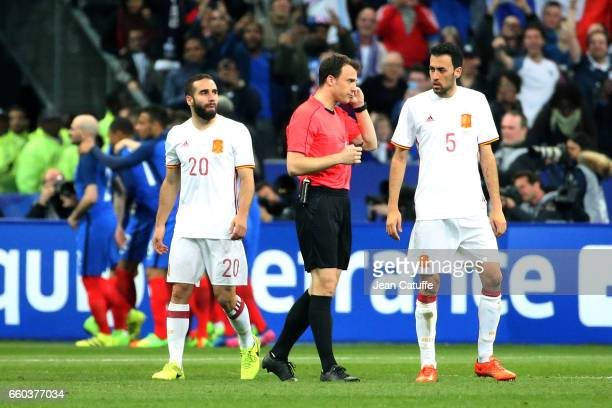 Referee Felix Zwayer of Germany talks to the video assistant referee before taking a decision during the international friendly match between France...