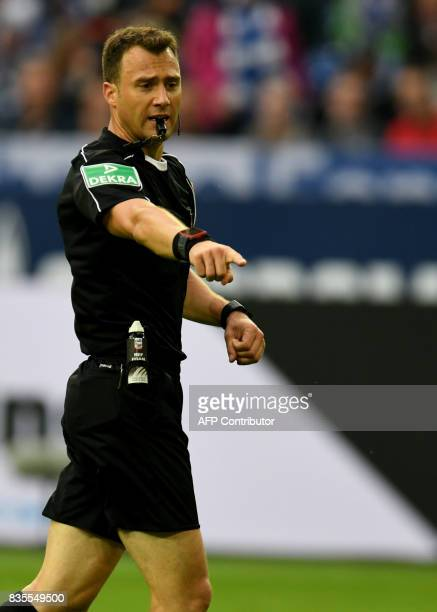 Referee Felix Zwayer reacts during the German First division Bundesliga football match FC Schalke 04 vs RB Leipzig in Gelsenkirchen western Germany...