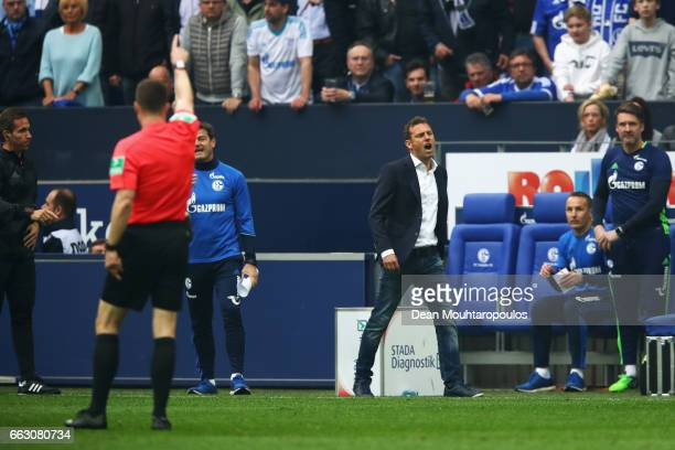 Referee Felix Zwayer sends Schalke Manager / Head Coach Markus Weinzierl to the stands with a red card during the Bundesliga match between FC Schalke...
