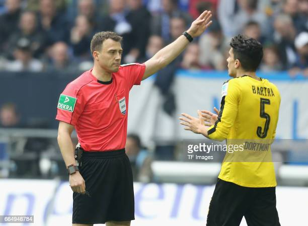 Referee Felix Zwayer speak with Marc Bartra of Dortmund during the Bundesliga match between FC Schalke 04 and Borussia Dortmund at VeltinsArena on...