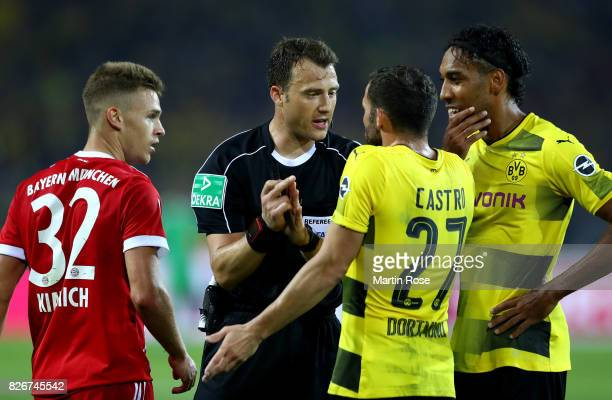 Referee Felix Zwayer talks to Castro of Dortmund during the DFL Supercup 2017 match between Borussia Dortmund and Bayern Muenchen at Signal Iduna...