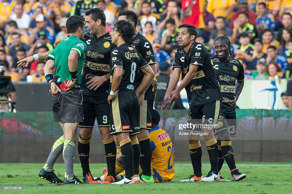 Referee Fernando Hernandez gives a red card to Severo Meza of Dorados during the 14th round match between Tigres UANL and Dorados de Sinaloa as part...