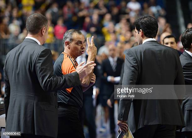 Referee Fernando Rocha speaks with coach Joan Plaza of Unicaja Malaga during the Turkish Airlines Euroleague Basketball Regular Season round 7 game...