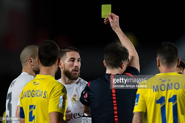 Referee Ferrnadez Borbalan shows the yellow card to Sergio Ramos of Real Madrid CF during the La Liga match between UD Las Palmas and Real Madrid CF...
