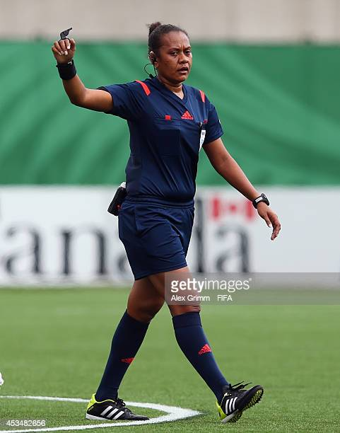 Referee Finau Vulivuli reacts during the FIFA U20 Women's World Cup Canada 2014 group C match between England and Mexico at Moncton Stadium on August...