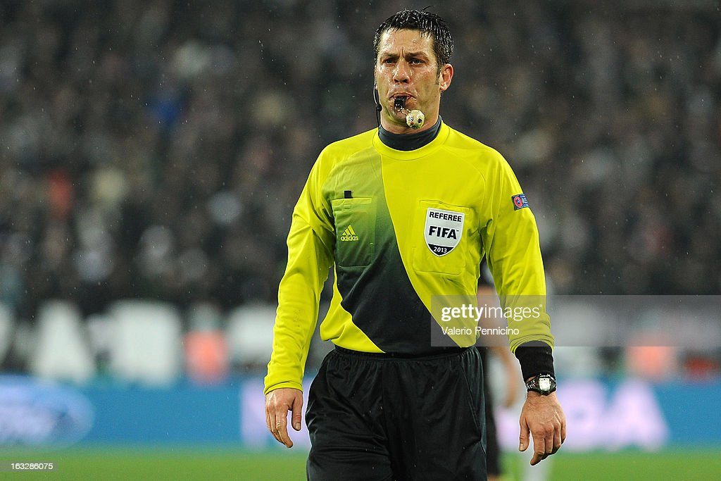 Referee Firat Aydinus signals a foul during the Champions League round of 16 second leg match between Juventus and Celtic at Juventus Arena on March 6, 2013 in Turin, Italy.