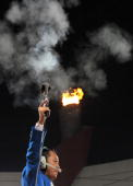A referee fires the start gun during the atheltics events at the National stadium as part of the 2008 Beijing Olympic Games on August 17 2008 AFP...