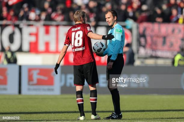 Referee Florian Heft speak with Hanno Behrens of FC Nuernberg during the Second Bundesliga match between 1 FC Nuernberg and SG Dynamo Dresden at...