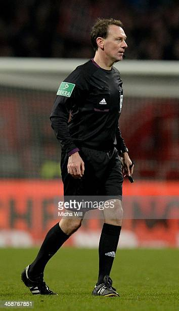 Referee Florian Meyer looks on during the Bundesliga match between 1 FC Nuernberg and FC Schalke 04 at Grundig Stadium on December 21 2013 in...