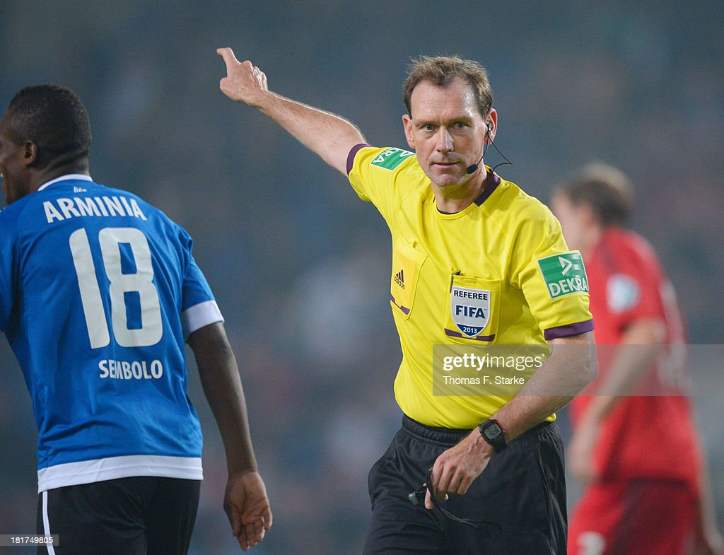 Referee Florian Meyer reacts during the DFB Cup match between Arminia Bielefeld and Bayer 04 Leverkusen at Schueco Arena on September 24, 2013 in Bielefeld, Germany.