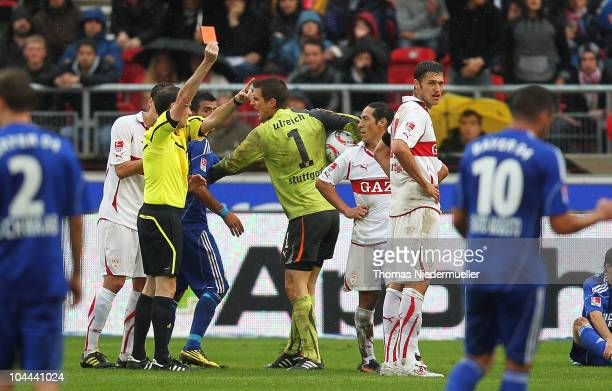 Referee Florian Meyer shows the red card to Mauro Camoranesi of Stuttgart during the Bundesliga match between VfB Stuttgart and Bayer Leverkusen at...