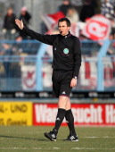 Referee Florian Steinberg rects during the 3rd Liga match between Chemnitz and Regensburg at Stadion an der Gellertstrasse on February 01 2014 in...