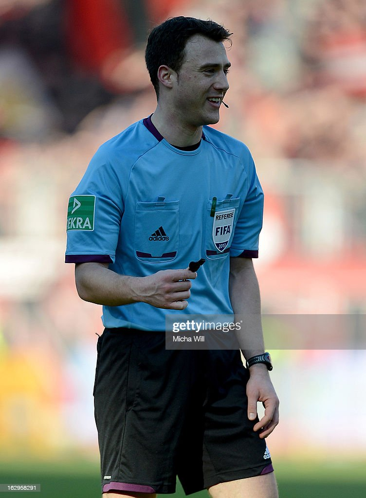 Referee Florian Steuer from Menden reacts during the Bundesliga Match between 1. FC Nuernberg and SC Freibug at Grundig Stadion on March 2, 2013 in Nuremberg, Germany.