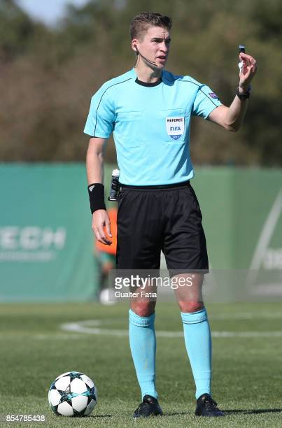 Referee Francois Letexier from France in action during the UEFA Youth League match between Sporting CP and FC Barcelona at CGD Stadium Aurelio...
