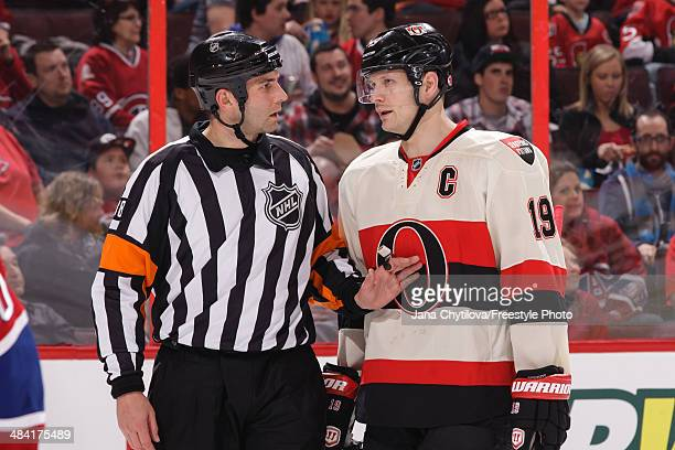 Referee Francois St Laurent talks with Jason Spezza of the Ottawa Senators during an NHL game against the Montreal Canadiens at Canadian Tire Centre...