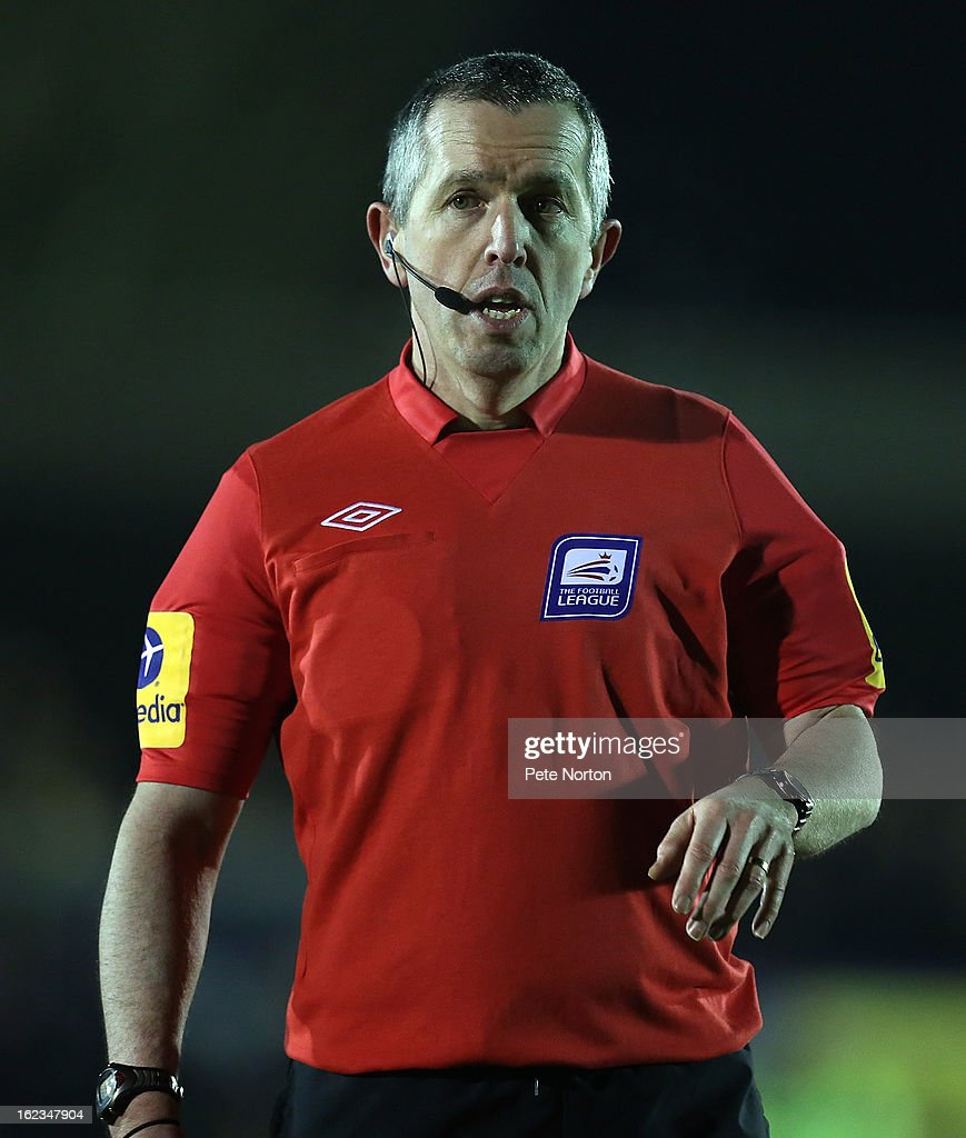 Referee Fred Graham in action during the npower League Two match between AFC Wimbledon and Northampton Town at The Cherry Red Records Stadium on February 19, 2013 in Kingston upon Thames, England.