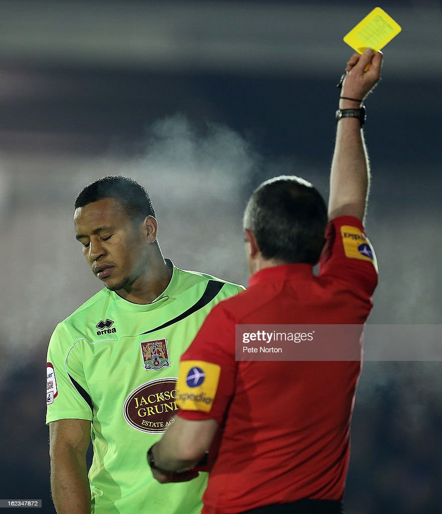 Referee Fred Graham shows a yellow card to Joe Widdowson of Northampton Town during the npower League Two match between AFC Wimbledon and Northampton Town at The Cherry Red Records Stadium on February 19, 2013 in Kingston upon Thames, England.