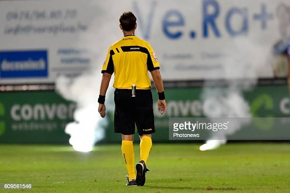 Referee Frederik Geldhof pictured in front of some firework during the Croky Cup 1/16 final match between SC Eendracht Aalst and KRC Genk in the...
