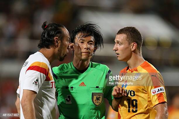 Referee Futosih Nakamura intervenes between Marcus Tulio Tanaka of Nagoya Grampus and Mitchell Duke of Shimizu SPulse during the JLeague match...