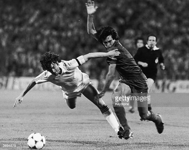 Referee Garcia Carrion watches as Jose Antonio Camacho of Real Madrid is tackled by Francisco Carrasco of Barcelona during the Spanish Cup final