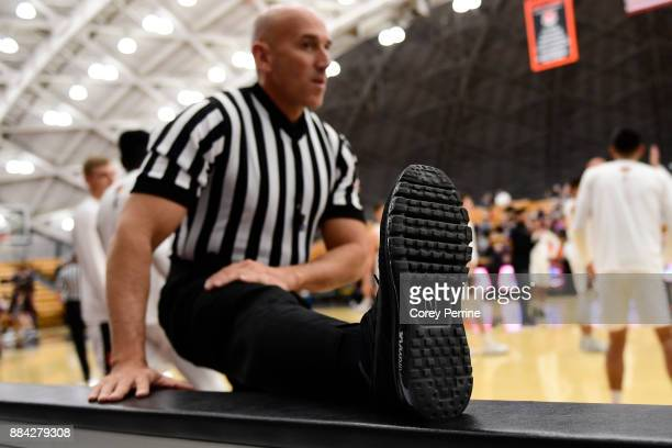Referee Garrick Shannon stretches before the game as against the Princeton Tigers host the Lehigh Mountain Hawks at L Stockwell Jadwin Gymnasium on...