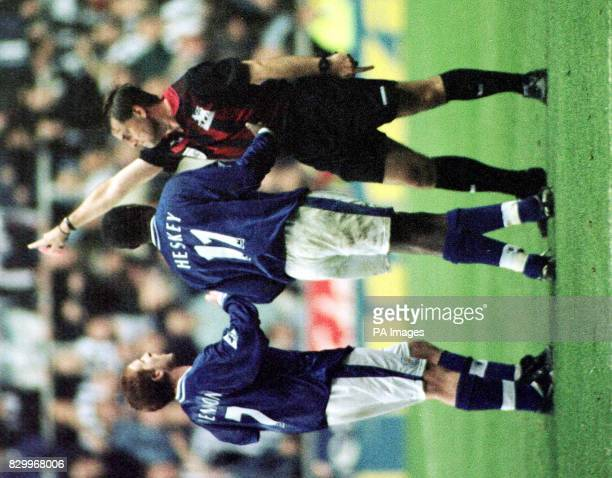 Referee Gary Willard orders Newcastle striker Emile Heskey off after an injury time clash with Leicester's Philippe Albert at St James's Park today...
