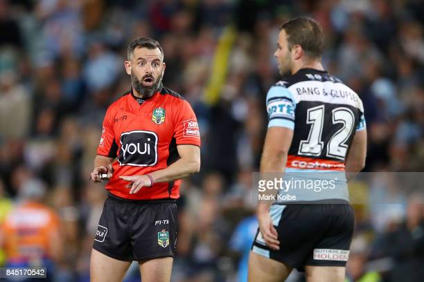 Referee Gavin Badger speaks to Wade Graham of the Sharks during the NRL Elimination Final match between the Cronulla Sharks and the North Queensland...