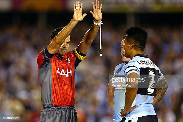 Referee Gavin Morris sends Sosaia Feki of the Sharks to the sin bin for throwing a punch during the round one NRL match between the Cronulla Sharks...