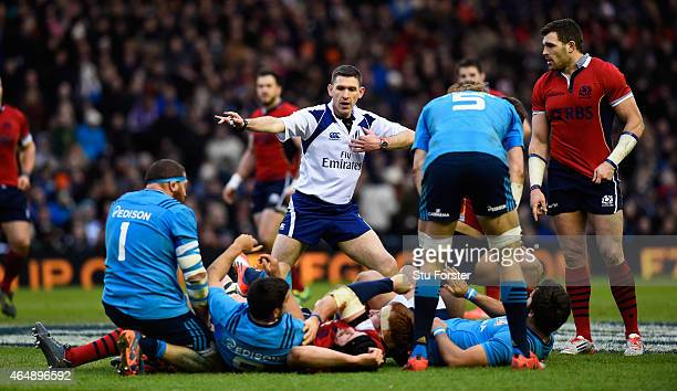 Referee George Clancy makes a decision during the RBS Six Nations match between Scotland and Italy at Murrayfield Stadium on February 28 2015 in...