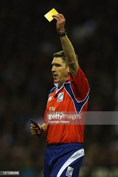 Referee George Clancy shows a yellow card during the QBE International match between England and New Zealand at Twickenham Stadium on December 1 2012...