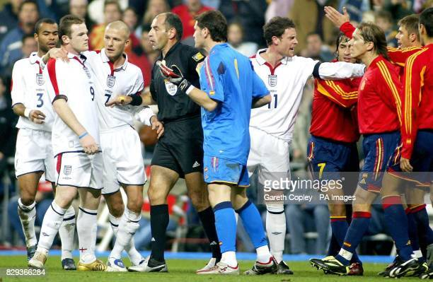 Referee George Kasnaferis breaksup the confrontation between England's Wayne Rooney and Spanish goalkeeper Casillas following an incident between the...