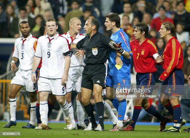 Referee George Kasnaferis keeps apart England's Wayne Rooney from Spanish goalkeeper Casillas during their international friendly match at the...