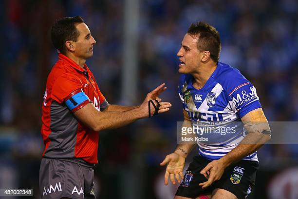 Referee Gerard Sutton looks on a Josh Reynolds of the Bulldogs makes his point during the round 20 NRL match between the Canterbury Bulldogs and the...